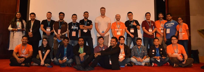 Members of WordPress are gathered in a group photo.